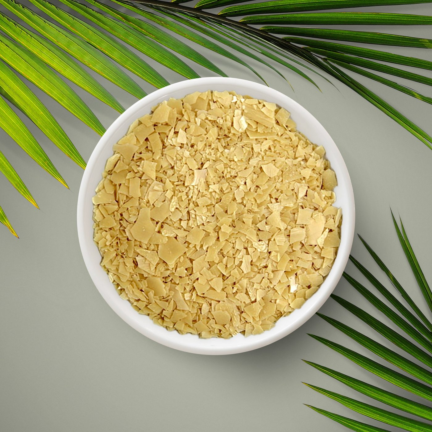 Light, brownish wax flakes. H Foster's carnauba wax is derived from palm leaves.