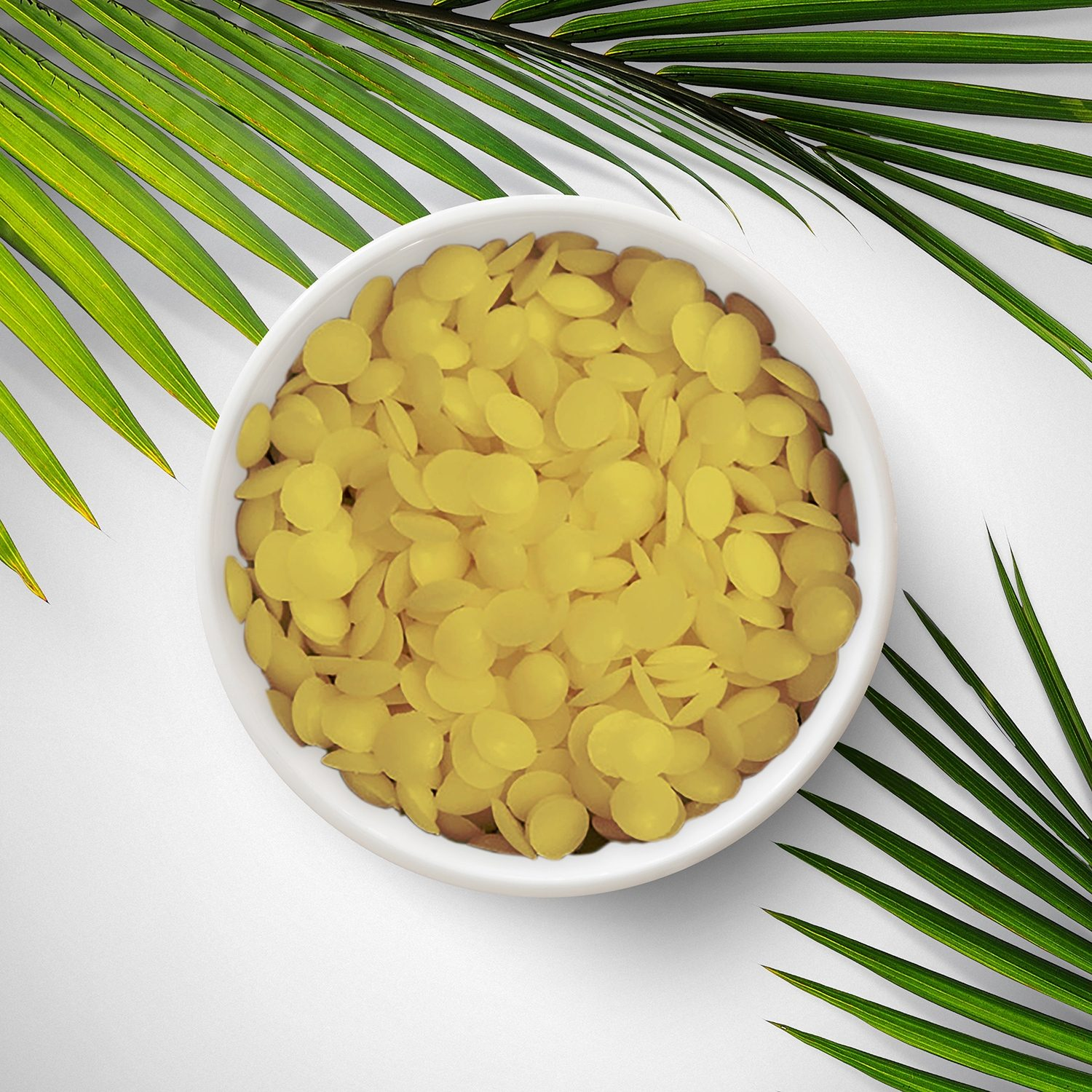 A small bowl of the filtrated wax pellets we stock, which are made from ageing palm leaves.