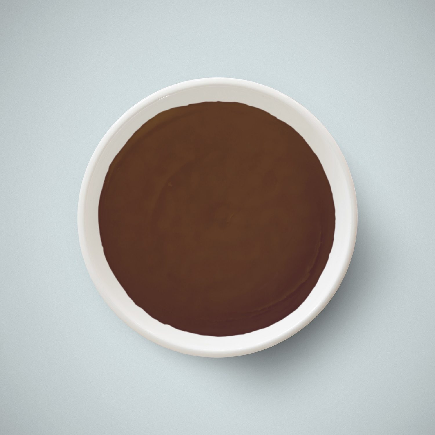 A small bowl that contains a dark brown grease called lanolin from H Foster.