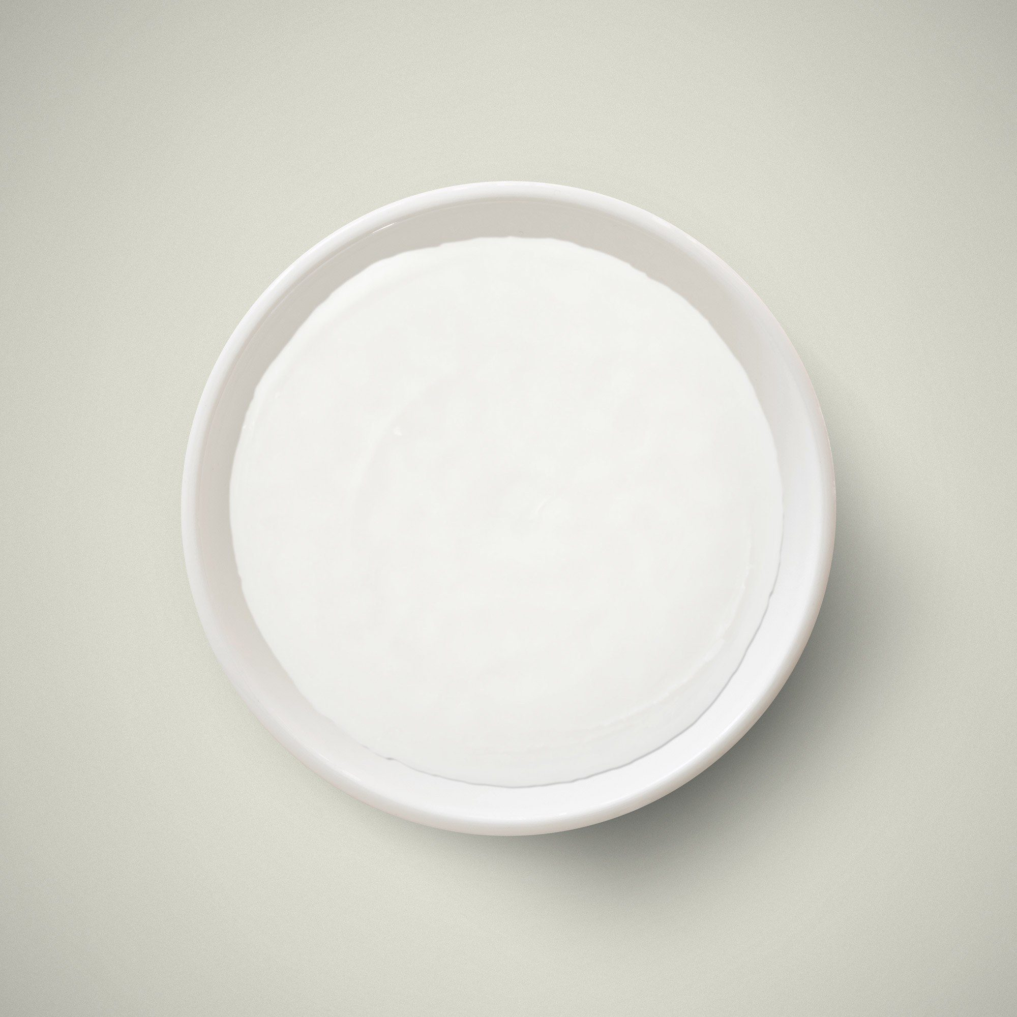 A bowl of white melt and pour soap base, which is available from H Foster.