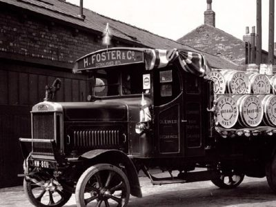 Old photograph of an H Foster wagon carrying barrels of products.